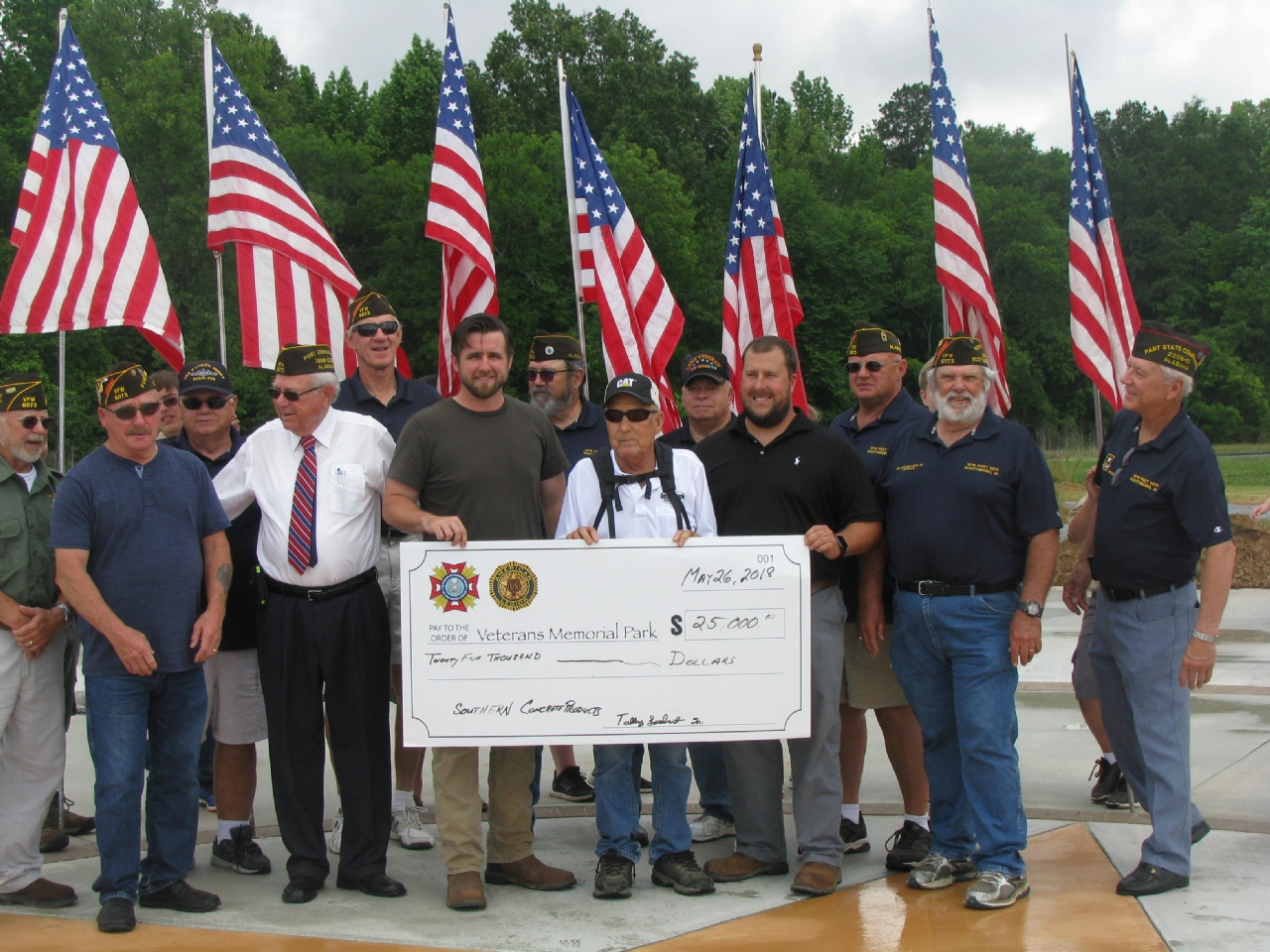 Members of VFW Post 6073 accept a Platinum donation to the Veterans Memorial Park during a celebration for the start of installation of the first inscribed brick pavers that have been purchased as a fund raiser for the park.